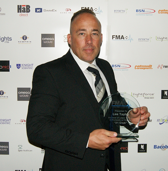 Lee Taylor poses with his FMA 21 Club award
